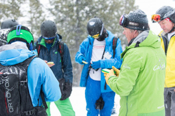 Before the cat skiing starts, participants receive important avalanche training.