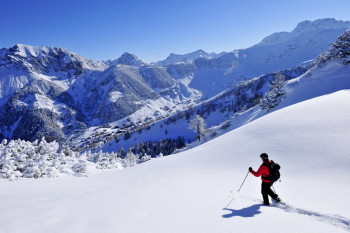 Explore the wintery landscabe of Malbun on a snowshoe tour.