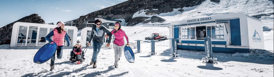 In der Ice Arena können Familien im Juli und August im Schnee spielen.