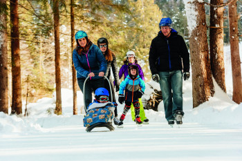 Ice skating in the forest is a great activity for a family day trip.