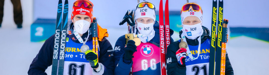 The three best in the individual race: Arnd Peiffer (2.), Sturla Holm Laegreid (1.) and Johannes Dale (3.)