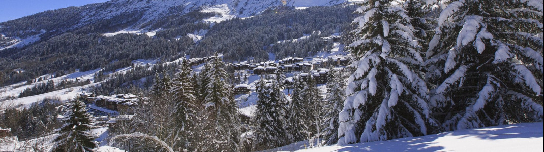 The idyllic ski resort Valmorel amidst the snowy winter landscape.