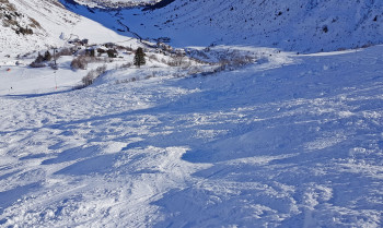 Observe the mogul from above before you get ready to ski down.