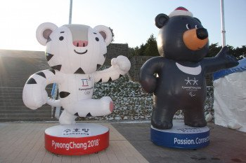 Guess who's already smiling down from huge billboards: The white tiger Soohorang and the black bear Bandabi are the Winter Olympics' mascots.