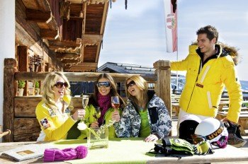 Clinking glasses of champagne at Saalbach Hinterglemm ski resort.
