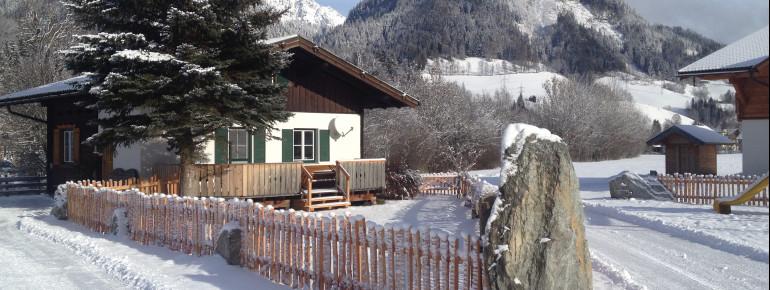 Ansicht Winter Ferienhaus - Blockhaus Abendrot