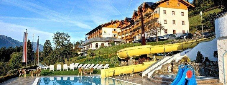 Hotel Glocknerhof - Schwimmbad mit Wasserrutsche in Kärnten