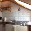 Küche der Ferienwohnung mit Balkon