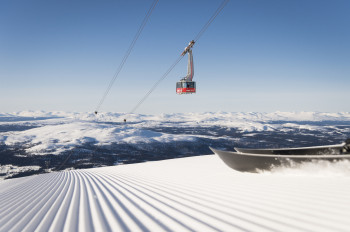 Modern lifts take you to perfectly groomed slopes.