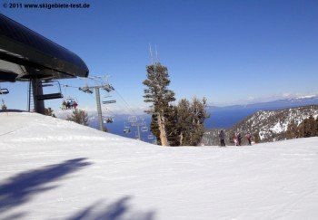 View of Gunbarrel Express Lift with Lake Tahoe in the background.
