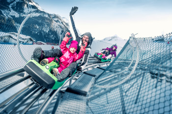 The Maisiflitzer, an Alpine Coaster on the Maiskogel, offers year-round sledding fun.