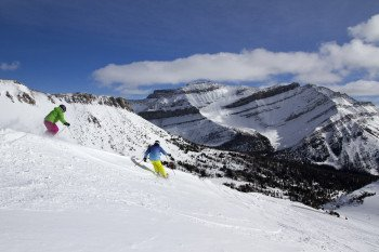 Skiing with a glorious view of the mountains and perfect snow conditions.