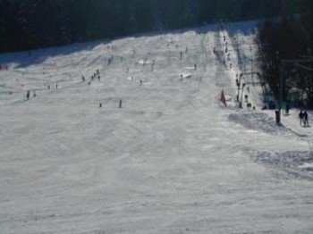 Well-groomed slopes are waiting for skiers.