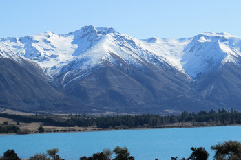 View of the glacial lake Ohau with Ohau ski field in the background.