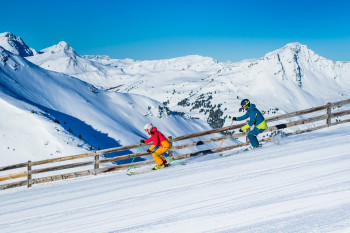 Skiing fun within a beautiful mountain landscape