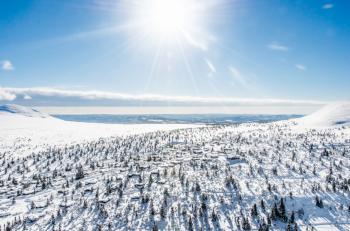 Skiing in the sun is twice the fun.