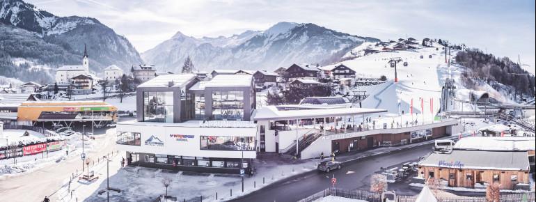 Der neue Einstieg in Kaprun: das Kaprun-Center als Talstation der MK Maiskogelbahn mit Skidepot, Sportshop und Verleihstation.